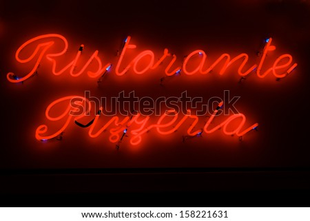 Italian Neon Sign with the words Ristorante and Pizzeria - stock photo