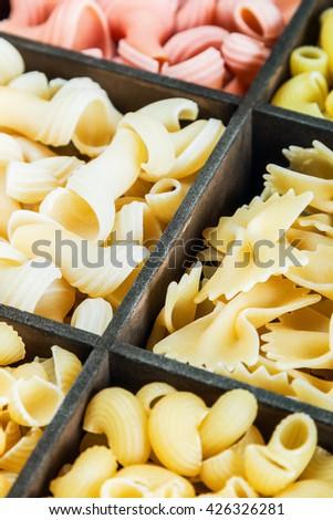 Italian pasta assortment grades background - stock photo