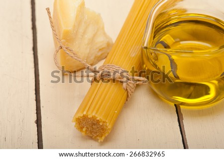 Italian pasta basic food ingredients parmesan cheese and extra virgin olive oil - stock photo