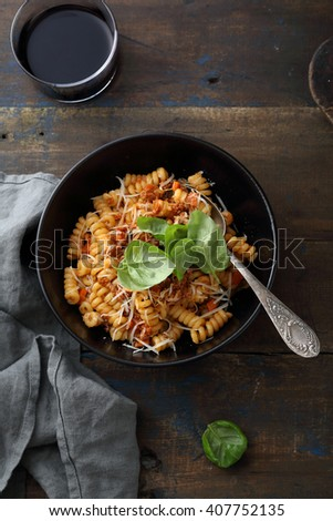 italian pasta bolognese with wine, food top view - stock photo