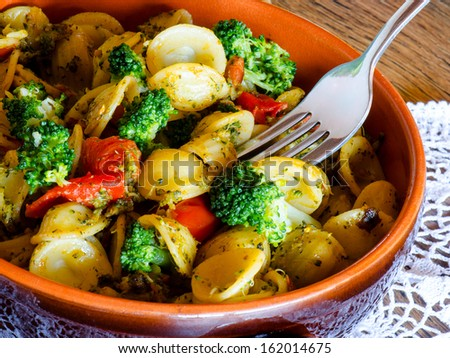 italian pasta called orecchiette with  typical italian recipe and vegetables  - stock photo