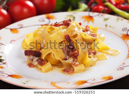 Italian pasta carbonara, pappardelle with pancetta bacon in egg and cheese sauce