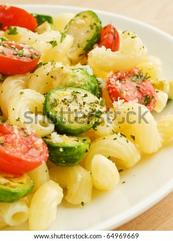 Italian pasta cavatappi with brussels sprouts and cherry tomatoes. Shallow dof.