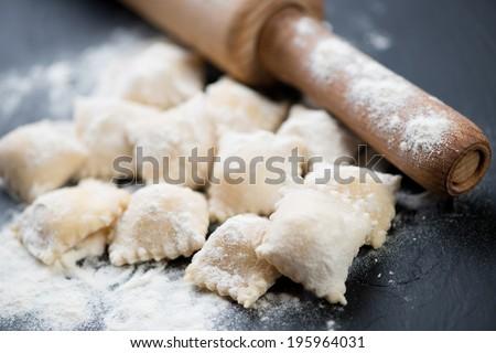 Italian pasta: cheese ravioli, horizontal shot, close-up - stock photo