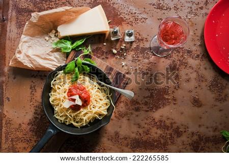 Italian pasta dinner (spaghetti, Parmesan, wine) - stock photo