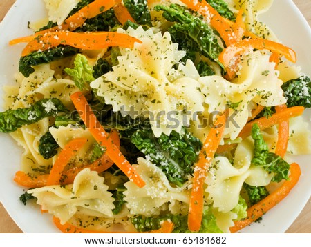 Italian pasta farfalle with peppers and savoy cabbage. Shallow dof. - stock photo
