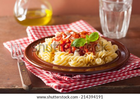 italian pasta fusilli with tomato sauce and basil - stock photo