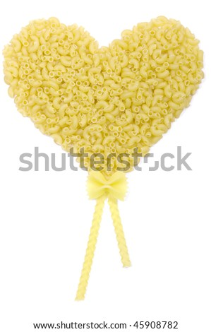 Italian pasta in the form of heart over white. Italian food background for Valentine's Day.