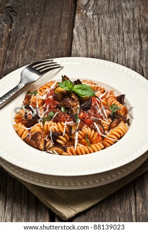 Italian Pasta Norma with tomato,ricotta cheese and eggplants - stock photo