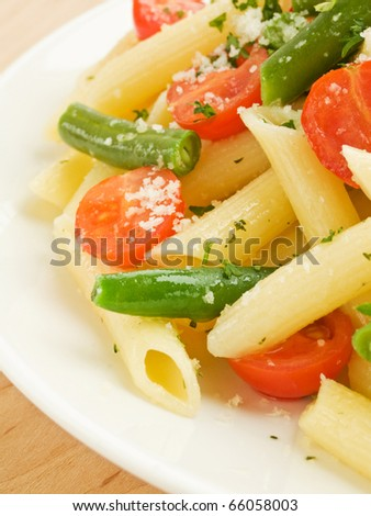 Italian pasta penne with cherry tomatoes and green beans. Shallow dof. - stock photo