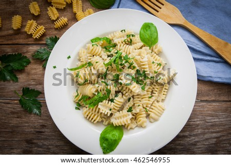 italian pasta radiatori with gorgonzola cheese and parsley on plate