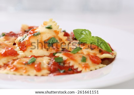 Italian Pasta Ravioli with tomato sauce noodles meal with basil on a plate - stock photo