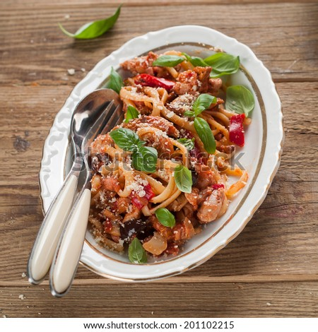 Italian pasta spaghetti with chicken and vegetable, selective focus - stock photo
