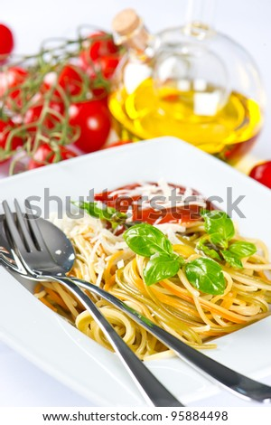 italian pasta spaghetti with parmesan, fresh basil, olive oil and red tomatoes on white background.