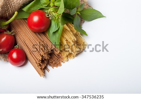 Italian pasta. Spaghetti with tomatoes in a sack isolated on white background - stock photo
