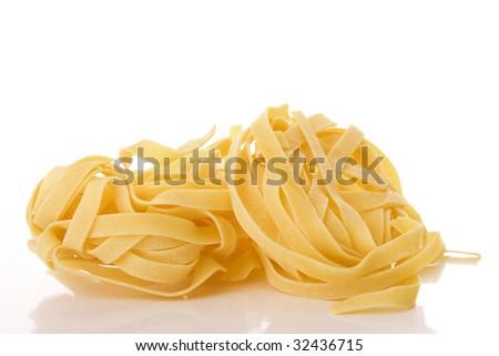 Italian pasta Tagliatelle isolated on white - stock photo