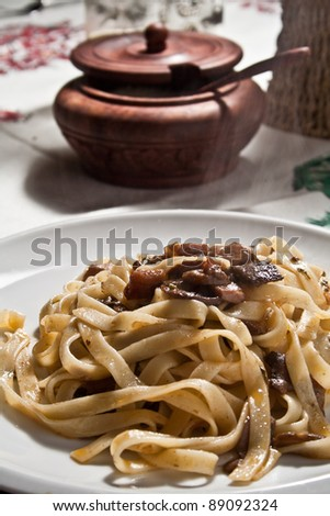 italian pasta tagliatelle with porcini mushroom - stock photo