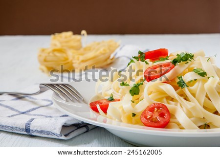 italian pasta tagliatelle with tomato and cheese sauce - stock photo