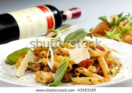 Italian pasta w chicken pieces and spinach - stock photo