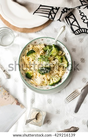 Italian pasta with broccoli and cheese parmesan - stock photo