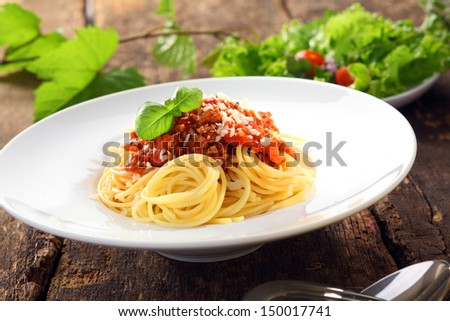 Italian pasta with carefully twirled spaghetti topped with a meat and tomato based bolognese, or bolognaise, sauce - stock photo