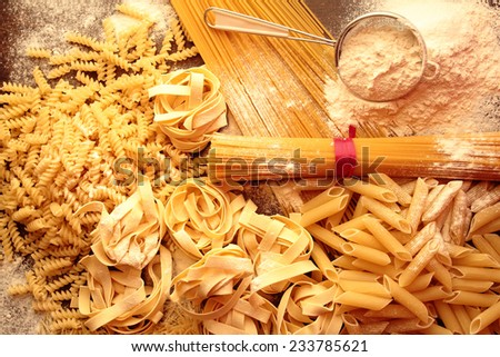 Italian pasta with mixed shapes and types with white flour - stock photo