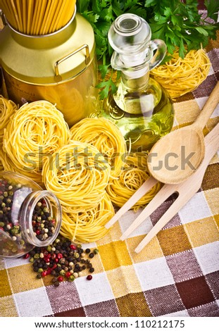 Italian pasta  with olive, spices, cheese and parsley - stock photo