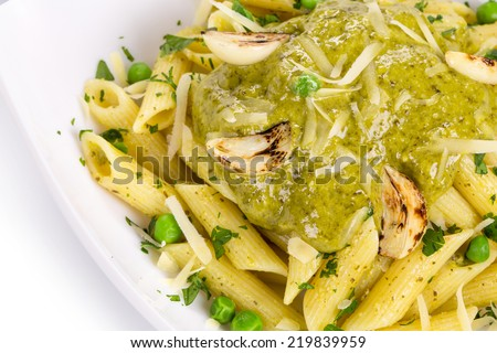 Italian pasta with pesto and herbs. Isolated on a white background.