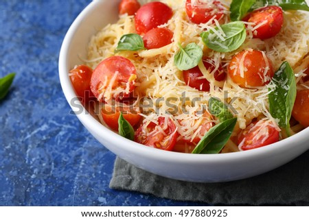 Italian pasta with roasted tomatoes, food closeup