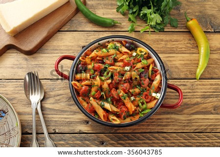 italian pasta with sausages in sauce tomato rustic table background - stock photo