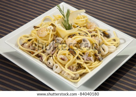 Italian pasta with seafood and rosemary - stock photo