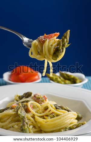 Italian pasta with tomatoes and asparagus.