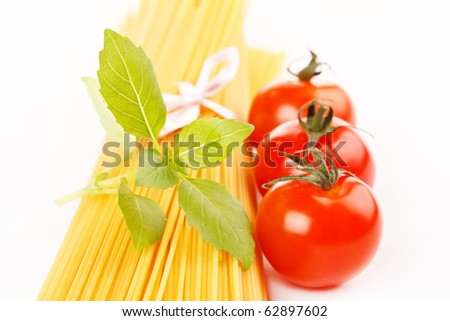 Italian Pasta with tomatoes and basil - stock photo