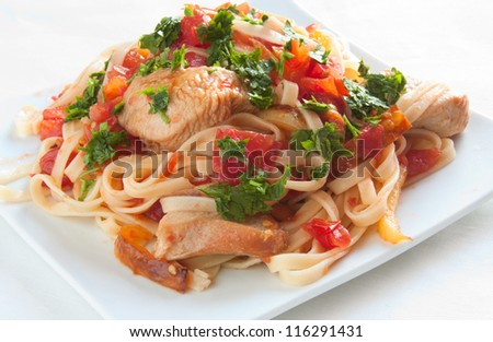 Italian pasta with tomatoes and meat close up - stock photo
