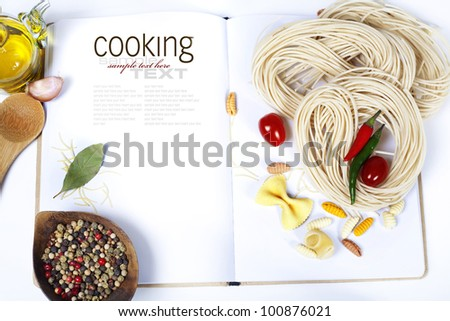 Italian Pasta with tomatoes, garlic, olive oil and pepper on a blanc notebook (with easy removable sample text) - stock photo