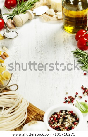 italian pasta with vegetables, herbs, spices, cheese and olive oil - stock photo