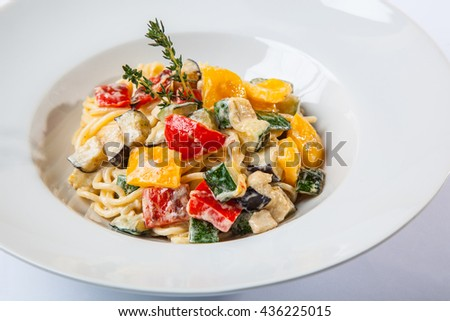 Italian Pasta with vegetables on plate - stock photo