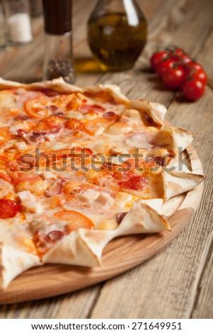 """Italian pizza """"Bavarian"""" on wooden table.  - stock photo"""