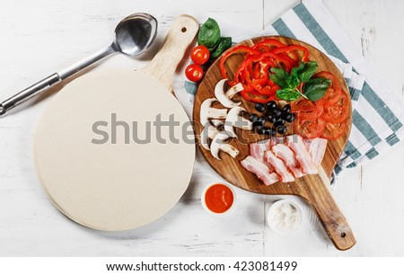 Italian pizza cooking process on white table. Backstage of preparation. Process step by step. Pizza dough and ingredients. Mushrooms Pepper, bacon, basil, olives, cheese, tomato cherry, sauce.  - stock photo