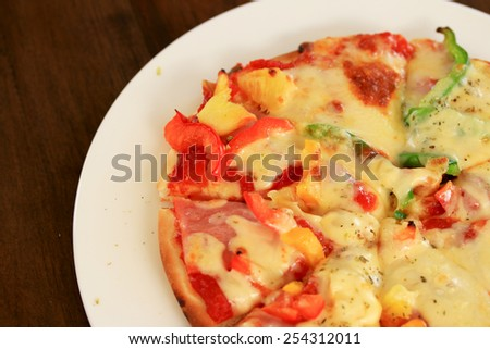 Italian pizza ham cheese and pepper