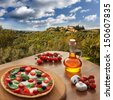 Italian pizza in Chianti, famous vineyard landscape in Italy - stock photo