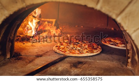 italian pizza is cooked in a woodfired oven