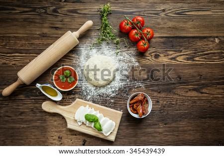 Italian pizza preparation. - stock photo