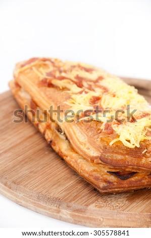 Italian pizza sandwich with cheese, ham, tomato and mushrooms. - stock photo