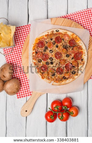 Italian pizza served on wooden table, close-up. - stock photo