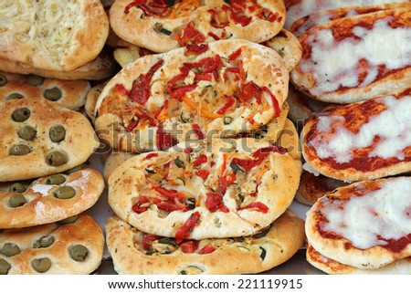 italian pizza snacks on market, Italy - stock photo
