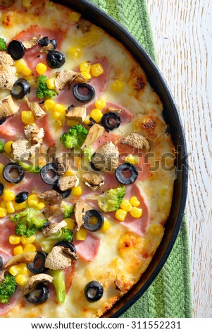 "Italian pizza ""Vegetarian"" on wooden table - stock photo"