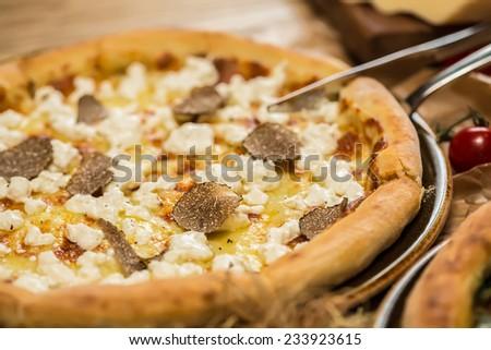 italian pizza with black truffles. Shallow dof. - stock photo