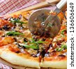 Italian pizza with mushrooms and olives on a wooden table - stock photo