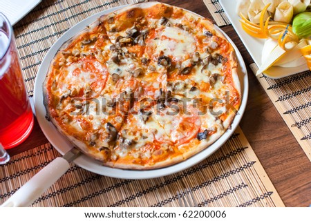 Italian pizza with mushrooms on table